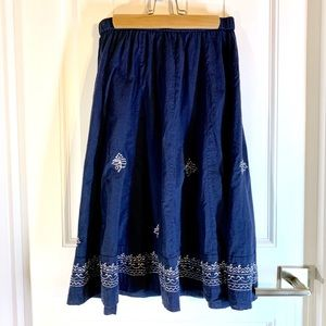 Cotton skirt with intricate silver embroidery.